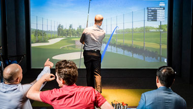 playing golf in TopGolf Swing Suite