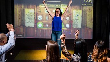 woman celebrating in Topgolf Swing Suite